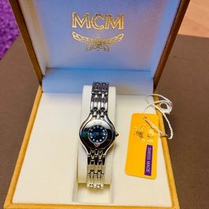 authentic MCM ladies watch in silver tone